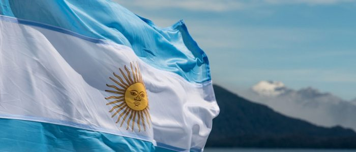 51097597 - argentina flag with mountains in background