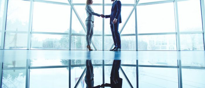 36693357 - young business partners handshaking after making agreement
