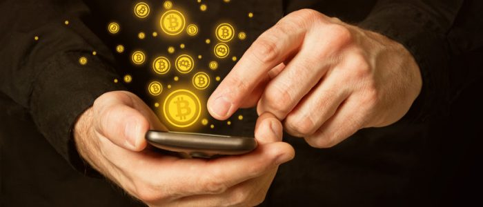 25089512 - hand holding smart phone mobile with bitcoin currency symbol