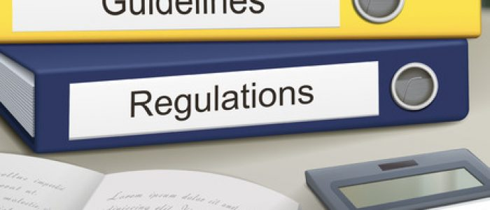 35449574 - guidelines and regulations binders isolated on the office table
