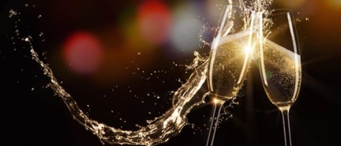 49294033 - glasses of champagne with splash, isolated on black
